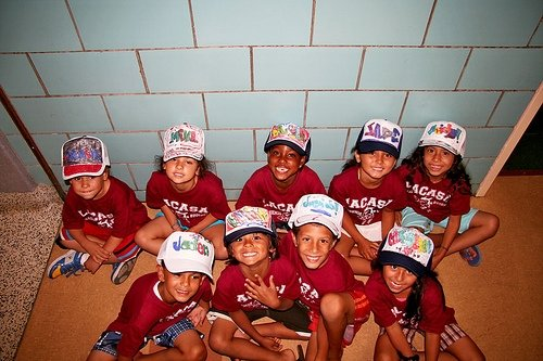 camp kids with caps